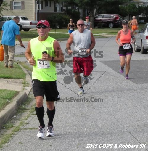 COPS & Robbers 5K Run/Walk<br><br><br><br><a href='http://www.trisportsevents.com/pics/15_COPS_&_Robbers_5K_129.JPG' download='15_COPS_&_Robbers_5K_129.JPG'>Click here to download.</a><Br><a href='http://www.facebook.com/sharer.php?u=http:%2F%2Fwww.trisportsevents.com%2Fpics%2F15_COPS_&_Robbers_5K_129.JPG&t=COPS & Robbers 5K Run/Walk' target='_blank'><img src='images/fb_share.png' width='100'></a>