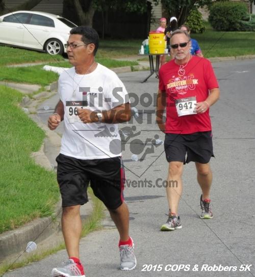 COPS & Robbers 5K Run/Walk<br><br><br><br><a href='https://www.trisportsevents.com/pics/15_COPS_&_Robbers_5K_131.JPG' download='15_COPS_&_Robbers_5K_131.JPG'>Click here to download.</a><Br><a href='http://www.facebook.com/sharer.php?u=http:%2F%2Fwww.trisportsevents.com%2Fpics%2F15_COPS_&_Robbers_5K_131.JPG&t=COPS & Robbers 5K Run/Walk' target='_blank'><img src='images/fb_share.png' width='100'></a>