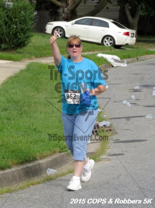 COPS & Robbers 5K Run/Walk<br><br><br><br><a href='http://www.trisportsevents.com/pics/15_COPS_&_Robbers_5K_161.JPG' download='15_COPS_&_Robbers_5K_161.JPG'>Click here to download.</a><Br><a href='http://www.facebook.com/sharer.php?u=http:%2F%2Fwww.trisportsevents.com%2Fpics%2F15_COPS_&_Robbers_5K_161.JPG&t=COPS & Robbers 5K Run/Walk' target='_blank'><img src='images/fb_share.png' width='100'></a>