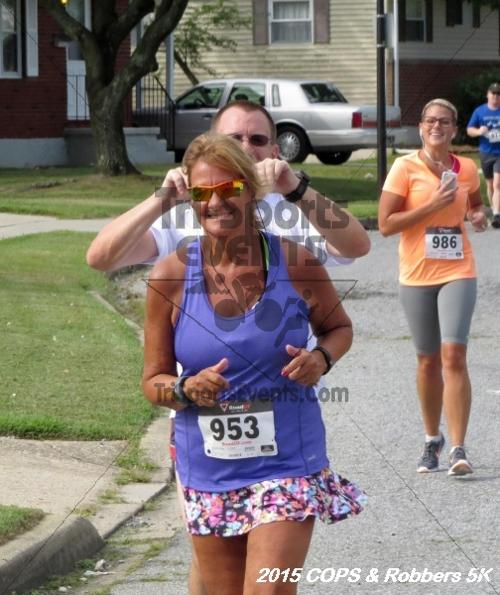 COPS & Robbers 5K Run/Walk<br><br><br><br><a href='https://www.trisportsevents.com/pics/15_COPS_&_Robbers_5K_173.JPG' download='15_COPS_&_Robbers_5K_173.JPG'>Click here to download.</a><Br><a href='http://www.facebook.com/sharer.php?u=http:%2F%2Fwww.trisportsevents.com%2Fpics%2F15_COPS_&_Robbers_5K_173.JPG&t=COPS & Robbers 5K Run/Walk' target='_blank'><img src='images/fb_share.png' width='100'></a>