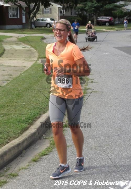COPS & Robbers 5K Run/Walk<br><br><br><br><a href='https://www.trisportsevents.com/pics/15_COPS_&_Robbers_5K_174.JPG' download='15_COPS_&_Robbers_5K_174.JPG'>Click here to download.</a><Br><a href='http://www.facebook.com/sharer.php?u=http:%2F%2Fwww.trisportsevents.com%2Fpics%2F15_COPS_&_Robbers_5K_174.JPG&t=COPS & Robbers 5K Run/Walk' target='_blank'><img src='images/fb_share.png' width='100'></a>
