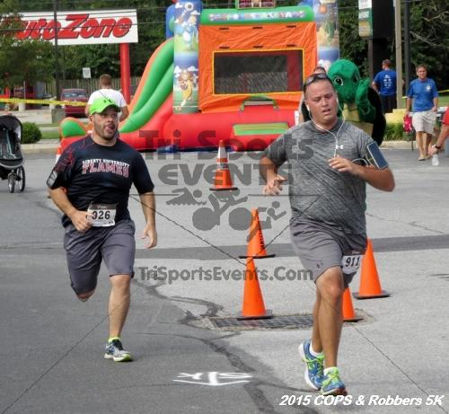 COPS & Robbers 5K Run/Walk<br><br><br><br><a href='https://www.trisportsevents.com/pics/15_COPS_&_Robbers_5K_182.JPG' download='15_COPS_&_Robbers_5K_182.JPG'>Click here to download.</a><Br><a href='http://www.facebook.com/sharer.php?u=http:%2F%2Fwww.trisportsevents.com%2Fpics%2F15_COPS_&_Robbers_5K_182.JPG&t=COPS & Robbers 5K Run/Walk' target='_blank'><img src='images/fb_share.png' width='100'></a>