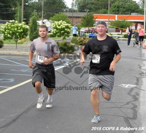 COPS & Robbers 5K Run/Walk<br><br><br><br><a href='https://www.trisportsevents.com/pics/15_COPS_&_Robbers_5K_196.JPG' download='15_COPS_&_Robbers_5K_196.JPG'>Click here to download.</a><Br><a href='http://www.facebook.com/sharer.php?u=http:%2F%2Fwww.trisportsevents.com%2Fpics%2F15_COPS_&_Robbers_5K_196.JPG&t=COPS & Robbers 5K Run/Walk' target='_blank'><img src='images/fb_share.png' width='100'></a>