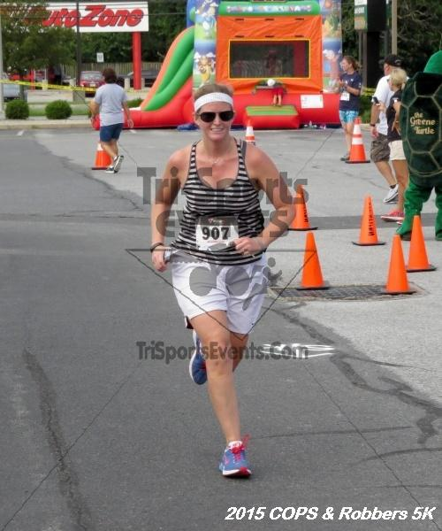 COPS & Robbers 5K Run/Walk<br><br><br><br><a href='https://www.trisportsevents.com/pics/15_COPS_&_Robbers_5K_198.JPG' download='15_COPS_&_Robbers_5K_198.JPG'>Click here to download.</a><Br><a href='http://www.facebook.com/sharer.php?u=http:%2F%2Fwww.trisportsevents.com%2Fpics%2F15_COPS_&_Robbers_5K_198.JPG&t=COPS & Robbers 5K Run/Walk' target='_blank'><img src='images/fb_share.png' width='100'></a>