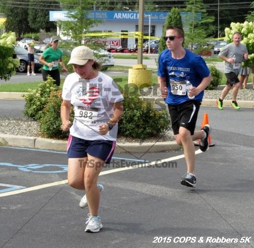 COPS & Robbers 5K Run/Walk<br><br><br><br><a href='https://www.trisportsevents.com/pics/15_COPS_&_Robbers_5K_220.JPG' download='15_COPS_&_Robbers_5K_220.JPG'>Click here to download.</a><Br><a href='http://www.facebook.com/sharer.php?u=http:%2F%2Fwww.trisportsevents.com%2Fpics%2F15_COPS_&_Robbers_5K_220.JPG&t=COPS & Robbers 5K Run/Walk' target='_blank'><img src='images/fb_share.png' width='100'></a>