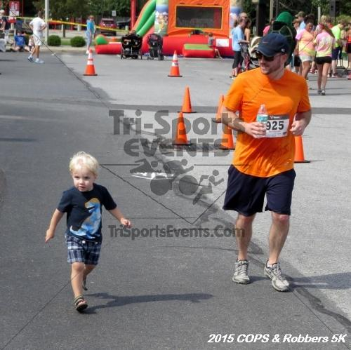 COPS & Robbers 5K Run/Walk<br><br><br><br><a href='https://www.trisportsevents.com/pics/15_COPS_&_Robbers_5K_254.JPG' download='15_COPS_&_Robbers_5K_254.JPG'>Click here to download.</a><Br><a href='http://www.facebook.com/sharer.php?u=http:%2F%2Fwww.trisportsevents.com%2Fpics%2F15_COPS_&_Robbers_5K_254.JPG&t=COPS & Robbers 5K Run/Walk' target='_blank'><img src='images/fb_share.png' width='100'></a>
