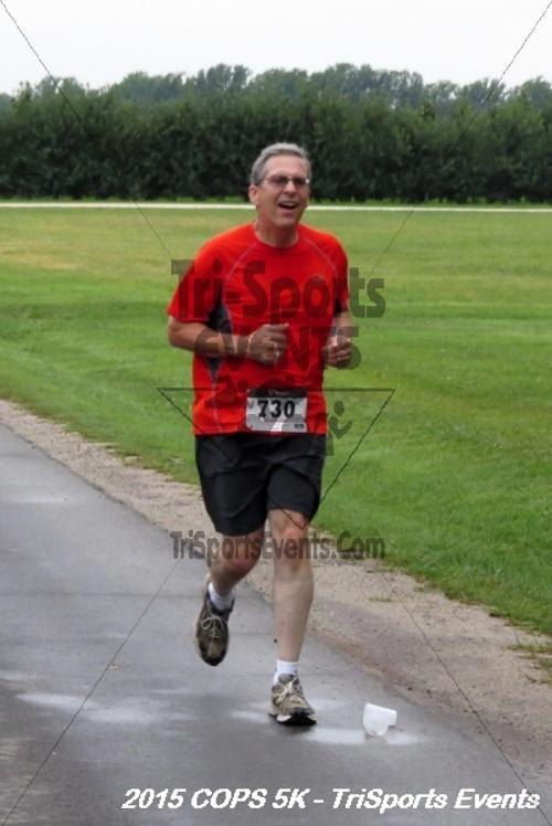 Concerns of Police Survivors (COPS) 5K Run/Walk<br><br><br><br><a href='http://www.trisportsevents.com/pics/15_COPS_5K_094.JPG' download='15_COPS_5K_094.JPG'>Click here to download.</a><Br><a href='http://www.facebook.com/sharer.php?u=http:%2F%2Fwww.trisportsevents.com%2Fpics%2F15_COPS_5K_094.JPG&t=Concerns of Police Survivors (COPS) 5K Run/Walk' target='_blank'><img src='images/fb_share.png' width='100'></a>