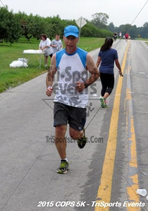Concerns of Police Survivors (COPS) 5K Run/Walk<br><br><br><br><a href='http://www.trisportsevents.com/pics/15_COPS_5K_099.JPG' download='15_COPS_5K_099.JPG'>Click here to download.</a><Br><a href='http://www.facebook.com/sharer.php?u=http:%2F%2Fwww.trisportsevents.com%2Fpics%2F15_COPS_5K_099.JPG&t=Concerns of Police Survivors (COPS) 5K Run/Walk' target='_blank'><img src='images/fb_share.png' width='100'></a>