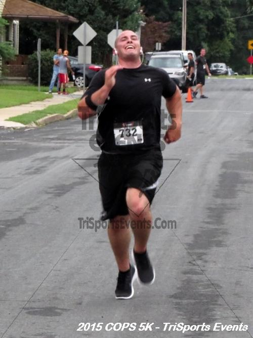 Concerns of Police Survivors (COPS) 5K Run/Walk<br><br><br><br><a href='https://www.trisportsevents.com/pics/15_COPS_5K_118.JPG' download='15_COPS_5K_118.JPG'>Click here to download.</a><Br><a href='http://www.facebook.com/sharer.php?u=http:%2F%2Fwww.trisportsevents.com%2Fpics%2F15_COPS_5K_118.JPG&t=Concerns of Police Survivors (COPS) 5K Run/Walk' target='_blank'><img src='images/fb_share.png' width='100'></a>