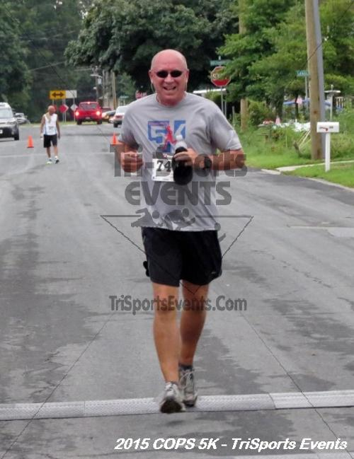 Concerns of Police Survivors (COPS) 5K Run/Walk<br><br><br><br><a href='http://www.trisportsevents.com/pics/15_COPS_5K_134.JPG' download='15_COPS_5K_134.JPG'>Click here to download.</a><Br><a href='http://www.facebook.com/sharer.php?u=http:%2F%2Fwww.trisportsevents.com%2Fpics%2F15_COPS_5K_134.JPG&t=Concerns of Police Survivors (COPS) 5K Run/Walk' target='_blank'><img src='images/fb_share.png' width='100'></a>