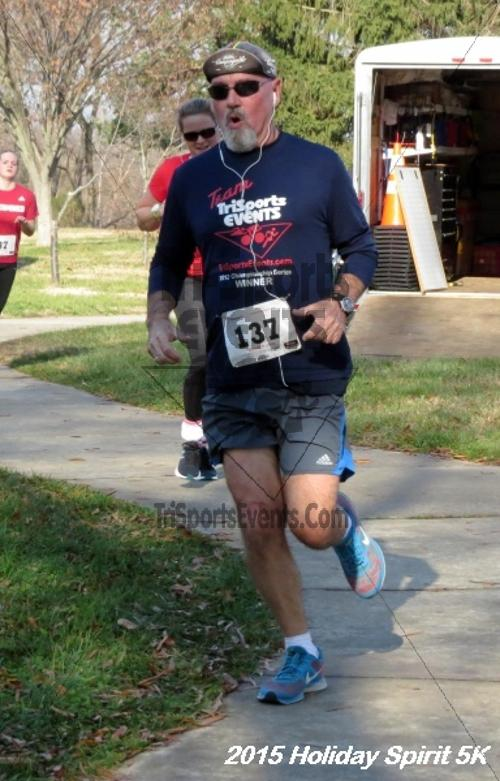 Share the Holiday Spirit 5K<br><br><br><br><a href='http://www.trisportsevents.com/pics/15_Holiday_Spirit_5K_098.JPG' download='15_Holiday_Spirit_5K_098.JPG'>Click here to download.</a><Br><a href='http://www.facebook.com/sharer.php?u=http:%2F%2Fwww.trisportsevents.com%2Fpics%2F15_Holiday_Spirit_5K_098.JPG&t=Share the Holiday Spirit 5K' target='_blank'><img src='images/fb_share.png' width='100'></a>