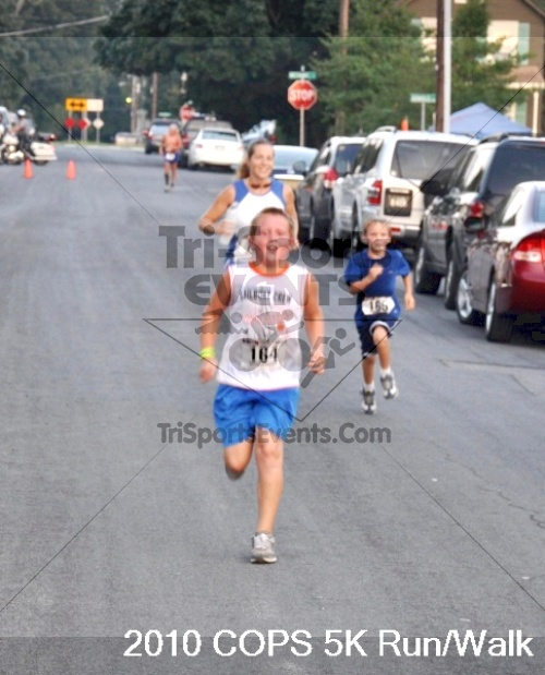 Concerns Of Police Survivors (COPS) 5K<br><br><br><br><a href='http://www.trisportsevents.com/pics/pic0759.JPG' download='pic0759.JPG'>Click here to download.</a><Br><a href='http://www.facebook.com/sharer.php?u=http:%2F%2Fwww.trisportsevents.com%2Fpics%2Fpic0759.JPG&t=Concerns Of Police Survivors (COPS) 5K' target='_blank'><img src='images/fb_share.png' width='100'></a>